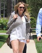http://img286.imagevenue.com/loc409/th_357436767_Hilary_Duff_house_hunting_in_Beverly_Hills12_122_409lo.jpg